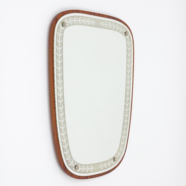 Lovely large Art Deco Mirror from Sweden, 1940s. A mahogany veneered backplate to which a mirror with etched border is attached with four nickeled knobs. Very good original condition with just minor ageing to the mirror.