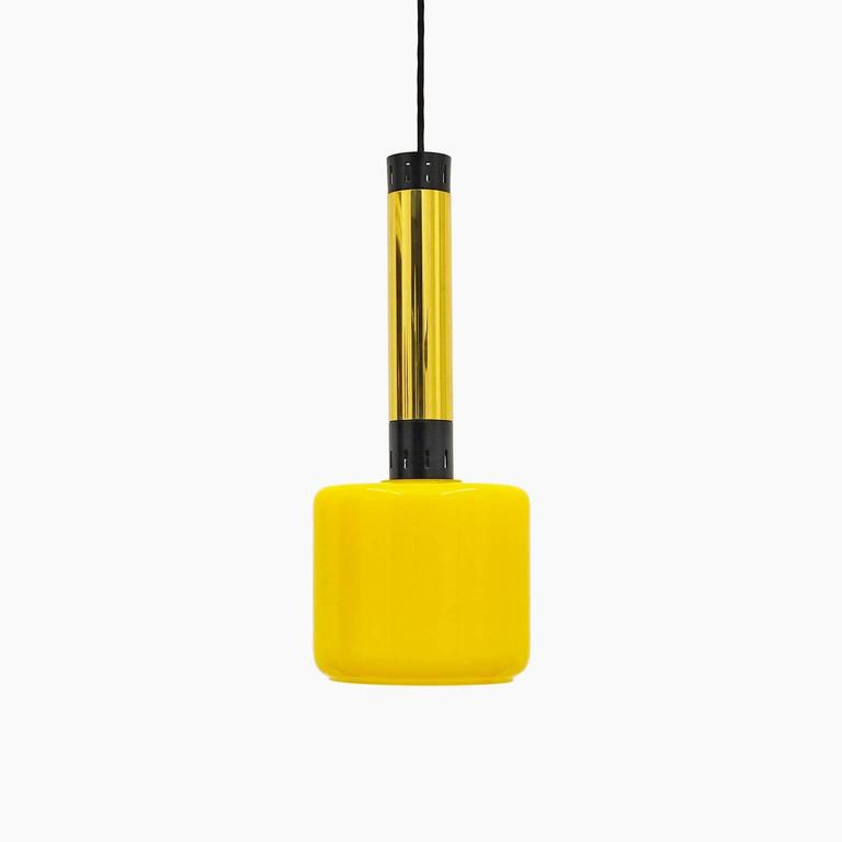 Pair of Stilnovo glass, brass and lacquered aluminum pendants from the 1950s. Lovely yellow blown glass diffusers with white inner casing. One original brass E27 socket with new textile wiring. Max drop height is 60 inches/154 cm.