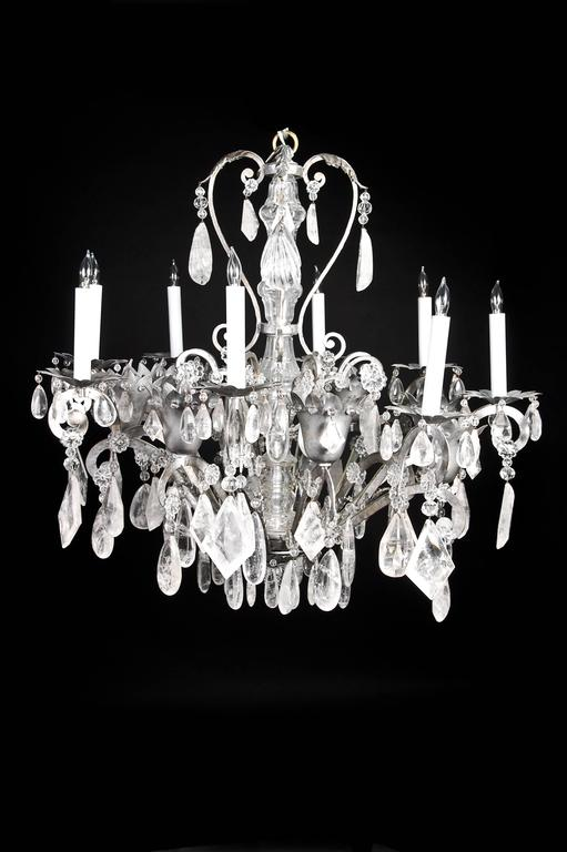 A fine French Bagues style silvered copper, cut rock crystal and glass multi light chandelier of great detail embellished with cut rock crystal prisms and glass beads.