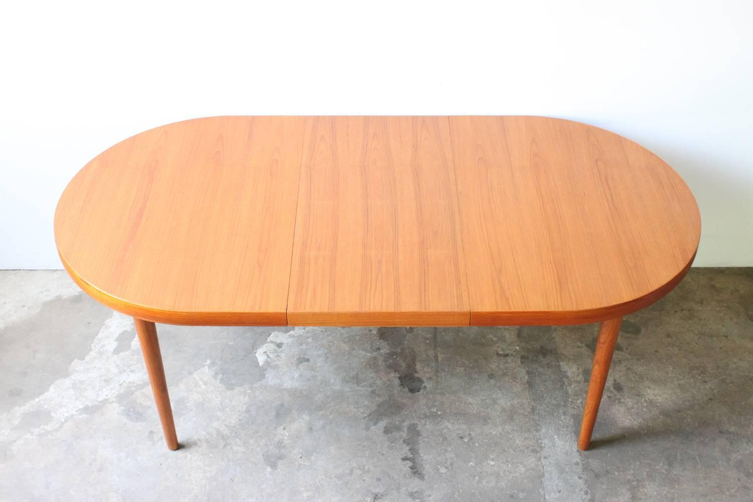 modern teak dining table