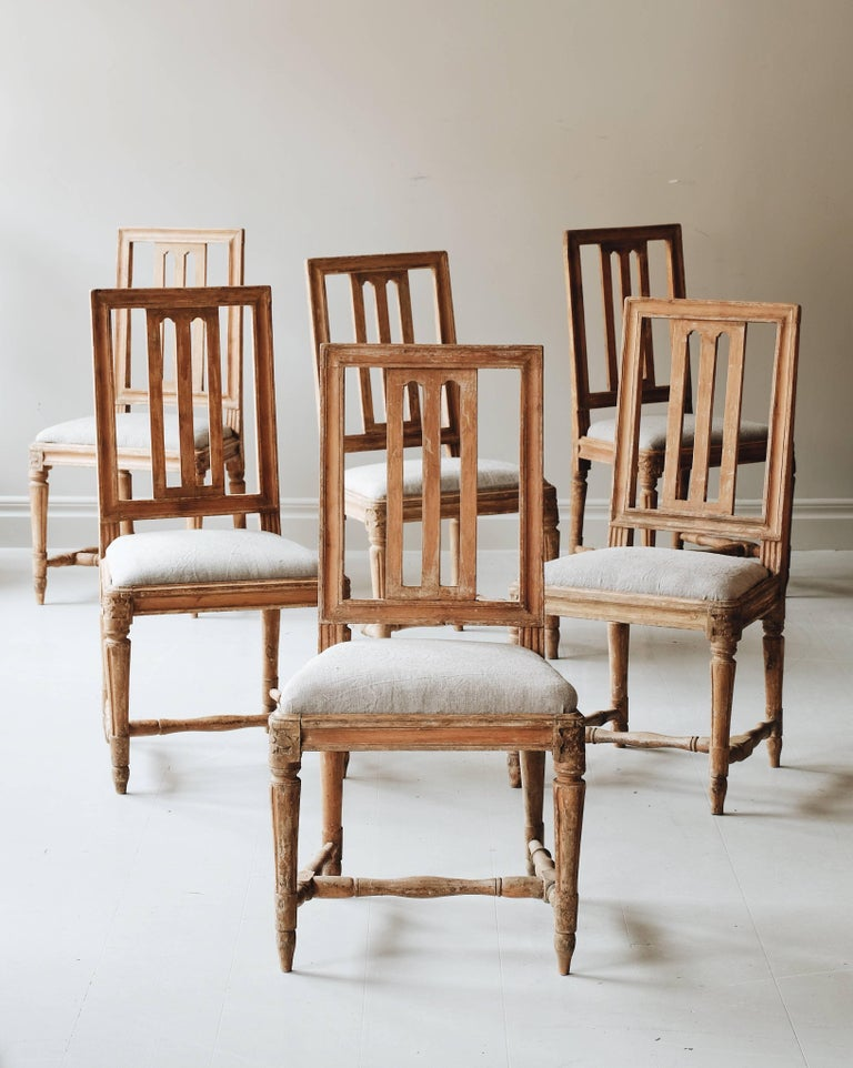 A fine set of ten matched (6 + 4) Early 19th-century Gustavian chairs in original color with retouches to make a set. Ca 1800, Stockholm, Sweden.   Attributed to master chairmaker Carl Johan Wadstrom (CIWS) 1788-1816, Two of the chairs with the seal
