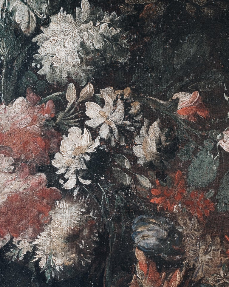 A fine pair of 18th century floral still life paintings. Reframed and unsigned, oil on canvas depicting floral arrangements with good execution, circa 1720, Dutch.  Good condition with wear and tear consistent with age and use.