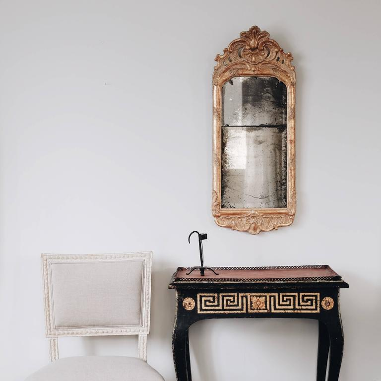 Fine 18th century Swedish Rococo giltwood mirror in original condition with great patina, circa 1760.  Condition: Excellent.  Wear: Wear consistent with age and use.  Finish: Original giltwood.  Hardware: Original mirror glass  Year: circa