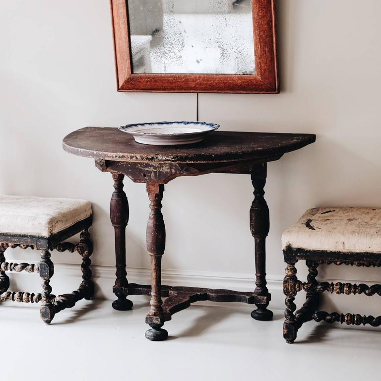 An unusual 18th century Swedish Baroque demilune console table in original color, circa 1730.   Condition: Good.   Wear: Wear consistent with age and use.   Finish: Original color with restored ball feet.  Year: circa 1730.