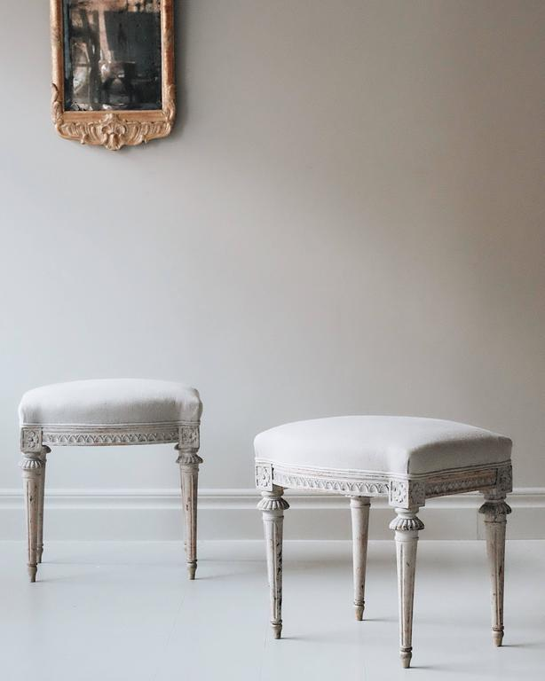Exceptional and elegant pair of early 19th century Gustavian stools in original color, marked with the Stockholm chair makers guild and signed by master chair maker Ephraim Sthal. ca 1810, Sweden.  Ephraim Sthal (Master 1794-1820): One of the most