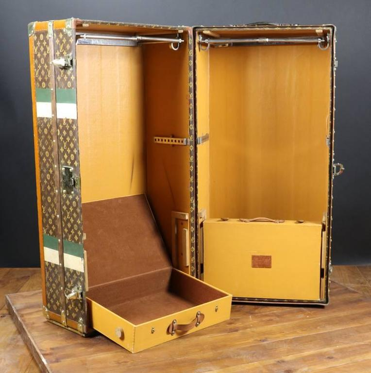 Louis Vuitton double monogram wardrobe - Solid brass lock and clasp - original Leather handles - stencil monogram canvas Wardrobe on each side 2 suitcase for shoes stabile strip, initial J.G Size in cm Width 56 cm X 113 cm high X 56 cm deep Malle