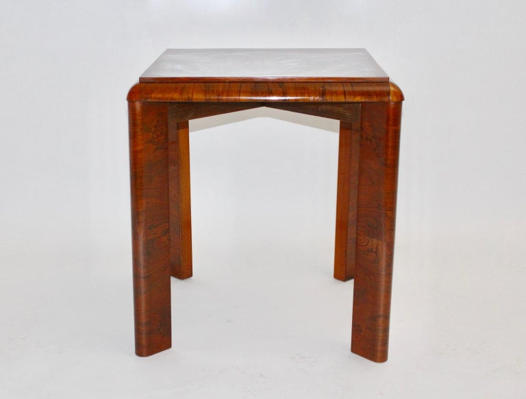 This square side table was made of spruce and walnut veneer. The top shows a very beautiful walnut veneer with burl wood - carefully hand polished.  Measures: Width 59 cm Depth 59 cm Height 66.5 cm.