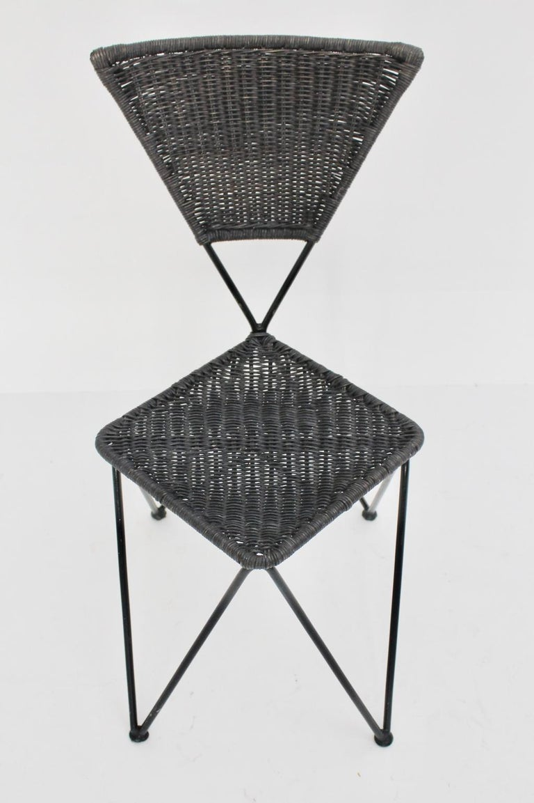 This rare garden chair by Karl Fostel Sen. Erben for Sonett, Vienna, circa 1950 features a black lacquered metal frame. Furthermore the seat and back was made of wicker and lacquered. It seems, that the original condition was dark blue, now the