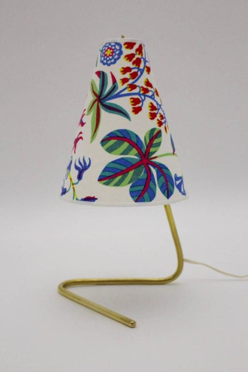 A wonderful mid century modern vintage table lamp by Rupert Nikoll, Vienna, Austria, 1950s, which tells great Austrian design spirit from the 1950s. Also the renewed lamp shade is covered with high quality Josef Frank design textile fabric by