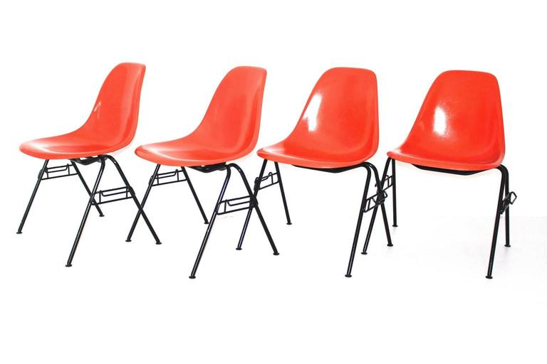 We present a classic icon: a set of four chairs,  model DSS - N, designed by Ray and Charles Eames 1950s and produced by Hermann Miller, Zeeland, Michigan, USA. These chairs are stackable ! Also the dining chairs are labeled under the seat.  The