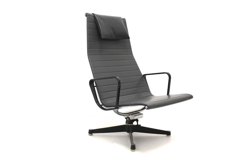 Very comfortable swiveling high back chair EA 124 from the 1950s. Designed by Ray & Charles Eames 1958 and produced by Herman Miller, USA.  The chair is equipped with a system to rock with the back seat. The frame is made of aluminium and the