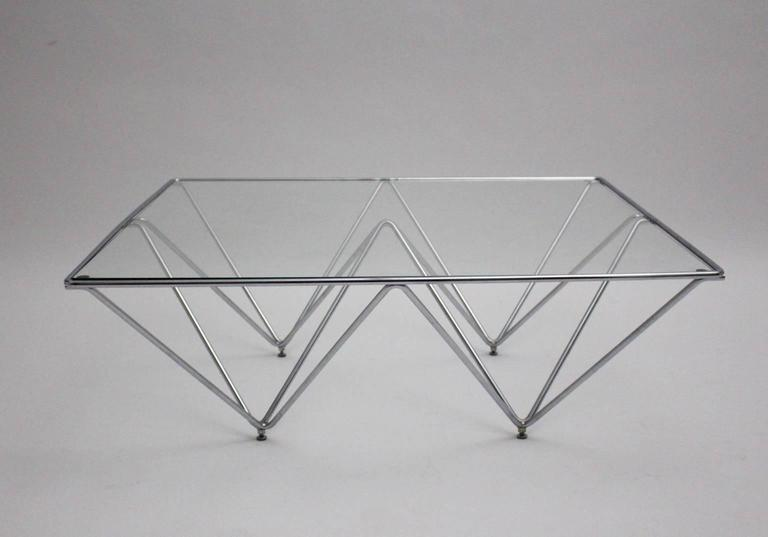 Iconic Italian design - base chromed tube steel in quadratic form clear glass top. 