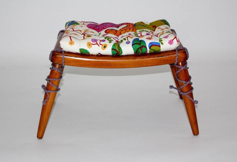 Very elegant cherrywood stool designed by the popular Viennese designer and architect Anna-Lülja Praun with steel springs and a loose seat cushion newly covered with luxurious Josef Frank linen fabric. The stool is carefully cleaned and