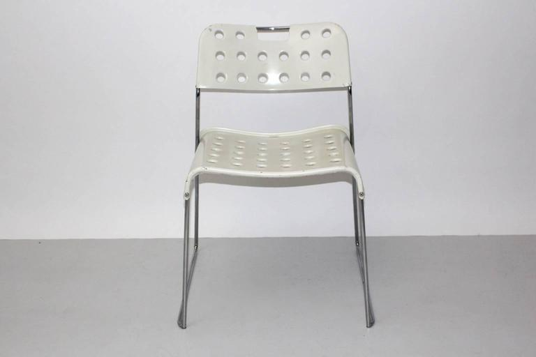 Space Age vintage white chair or side chair model Omstak designed by Rodney Kinsman 1971 and produced by Bieffeplast, Caselle di Selvazzano. The extraordinary chair shows perforated seat and back from metal covered with plastic. Very good condition