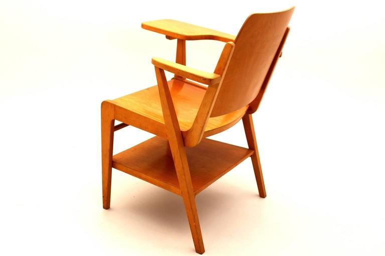 The writing chair was designed by Franz Schuster 1959 and produced by Wiesner-Hager.  The chair was made of solid beechwood and the seat and back were made of plywood. The features are a tray under the seat and a writing plate. This chair was