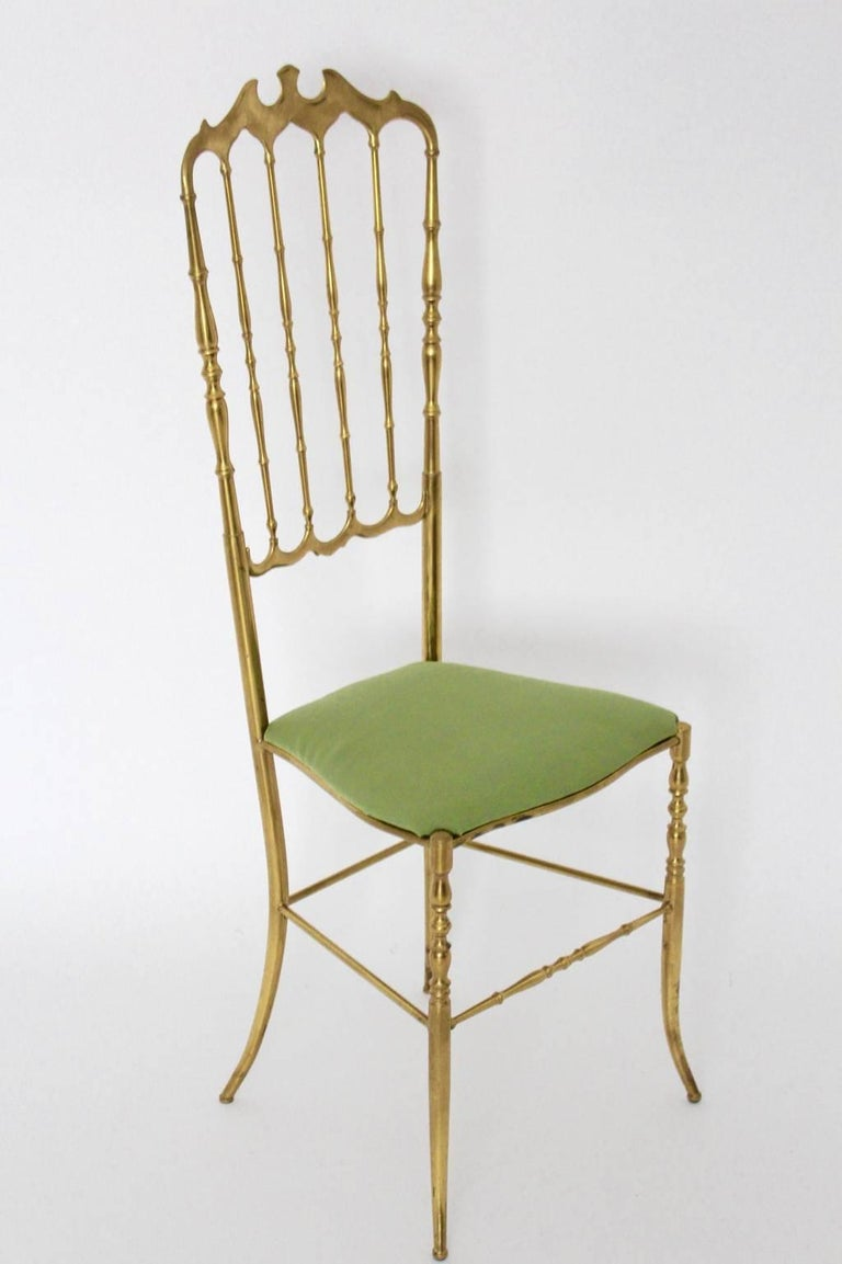 This chair by Chiavari 1950s Italy has a solid brass frame and a seat with renewed covering with green textile fabric.  The chair is carefully cleaned to preserve the charming brass patina. All measures are approximate