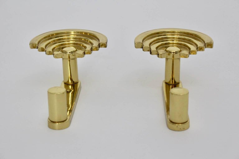 This pair of coat hooks designed by Ettore Sottsass circa 1985 are very rare. The coat hooks were made of solid polished brass and are in best condition. These coat hooks, which are shaped like a sunset, create a good mood!