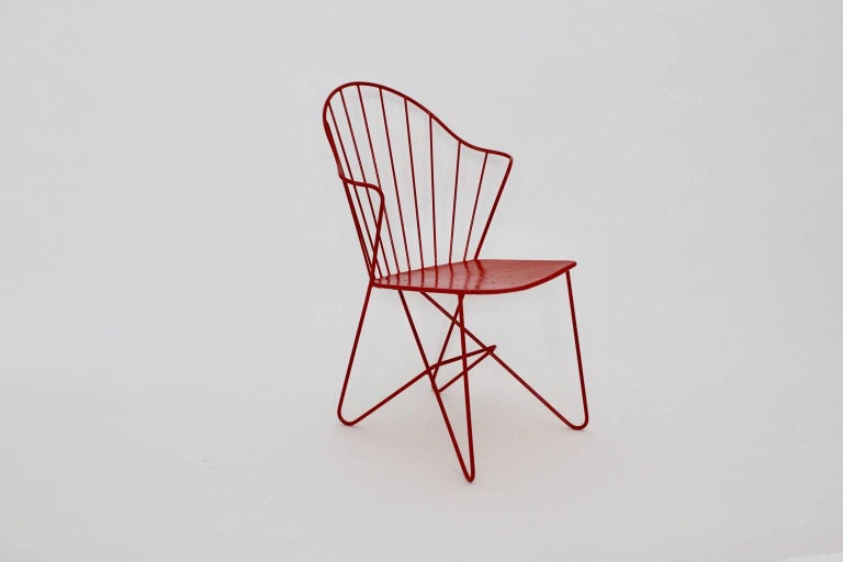 Red mid century modern side chair or chair model Astoria designed by the architects J.O. Wladar &   V. Moedlhammer circa 1955 and executed by Sonett Karl Fostel Sen.´s Erben, Vienna. The wire steel chair is newly lacquered.  all measures are