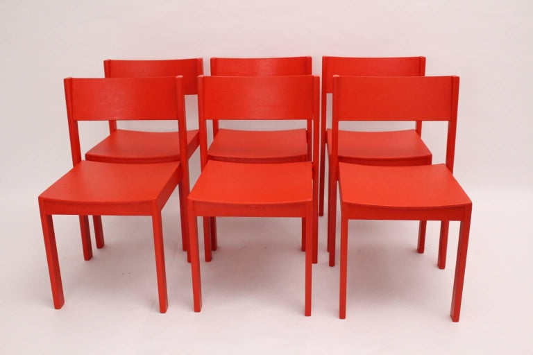 This set of six dining room chairs designed by Carl Auböck, 1956, Vienna and executed by E. & A. Pollack, Vienna. They are made of solid beechwood and plywood. These original very rare Carl Auböck Dining Room Chairs from the year 1956 are newly red