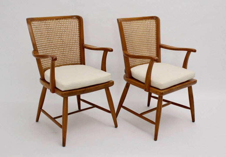 This pair of armchairs were designed by Josef Frank, Vienna, circa 1928 for Haus & Garten. The armchairs were made of ashwood and feature a Viennese mesh on the back.  The chairs are very comfortable and are equipped with new cushions. The indicated