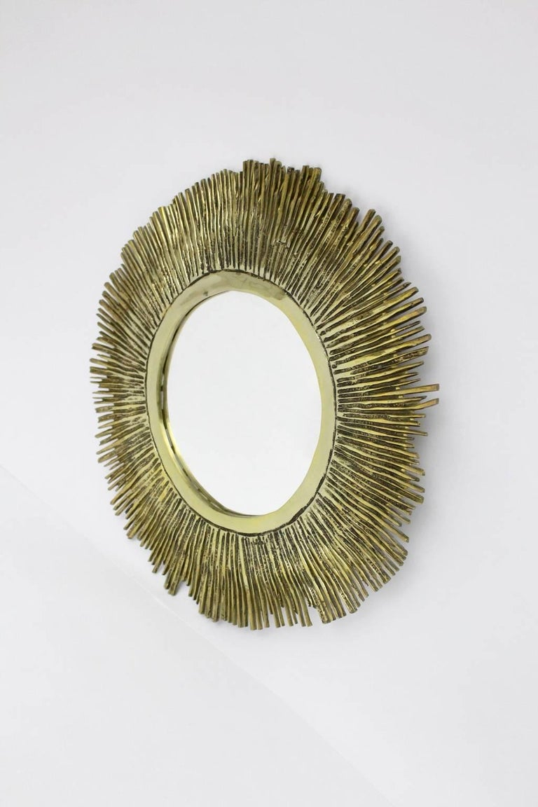 We present a huge solid brass cast sunburst mirror, which was designed in France during the 1960s.