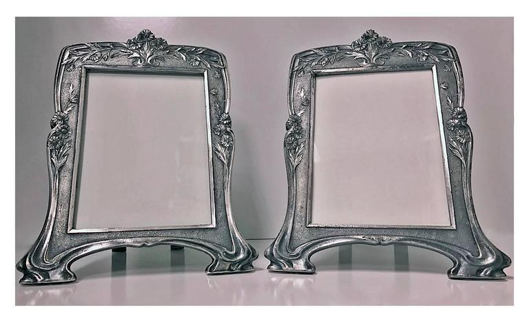 Rare Christofle Art Nouveau pair of photograph frames, circa 1900. Each with Christofle marks for Alfenide Gallia, a profile of a goat inside a rhombus in a square box and coat of arms with a Gallic cock and model numbers 4430. These frames are rare