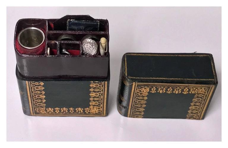 Rare 19th century sewing compendium in the form of a wonderful tooled leather bound book, entitled Lady's Companion, with English, circa 1830. The book opens to reveal compartmentalized Moroccan leather bound holders for various size needle storage