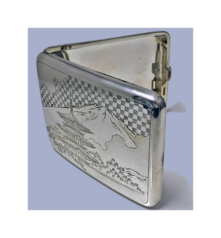 Fine Japanese 950 silver box case, circa 1920. Slightly concave, engraved with scenes of Mount Fuji and Pagoda building with foliage and pine trees, signed with character marks on underside. Measures: 4.25 x 3.00 inches. Weight: 116.04 grams. Minor