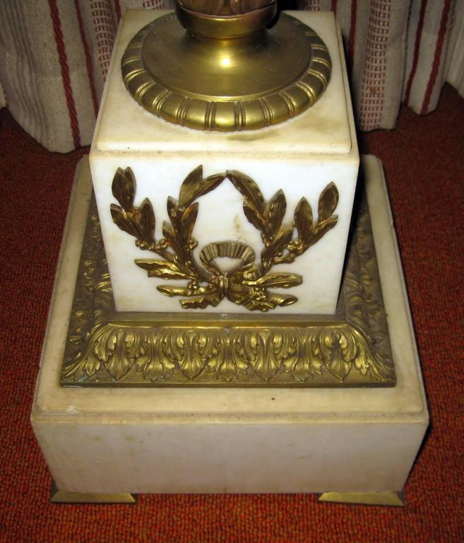 Louis XVI style French solid marble pedestal featuring gilt decoration and ormolu mounts in an acanthus leaf and laurel wreath motif.