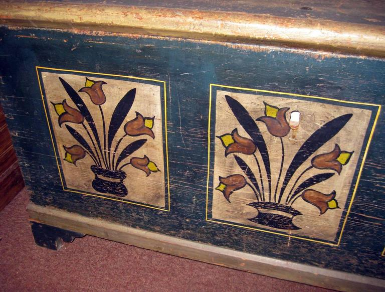 American Folk Art stenciled pine Pennsylvania Dutch blanket chest with original paint. On the top the paint is faded and a bit worn but the front and sides are strong with decorative vases of graceful tulips. Bracket feet. Original hand-wrought