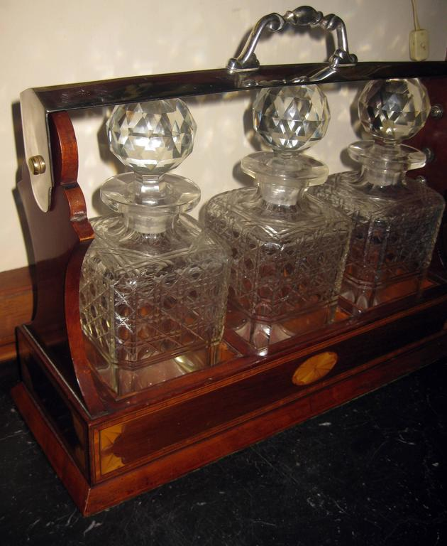 Cut Glass 19th Century Georgian Inlaid Mahogany Tantalus with Three Decanters For Sale