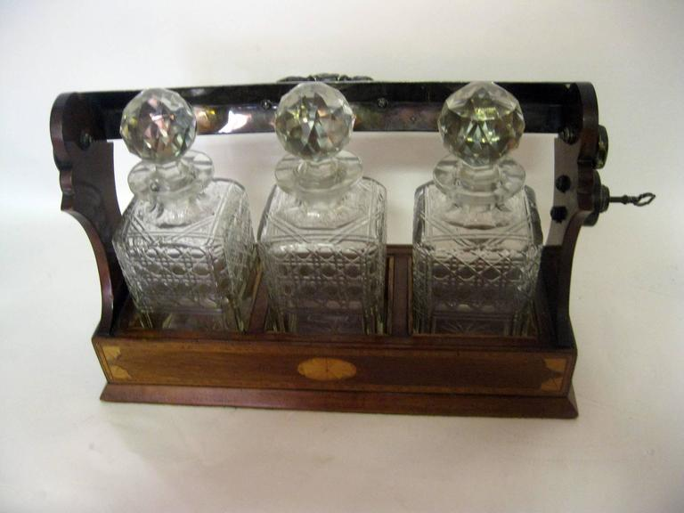 Inlay 19th Century Georgian Inlaid Mahogany Tantalus with Three Decanters For Sale