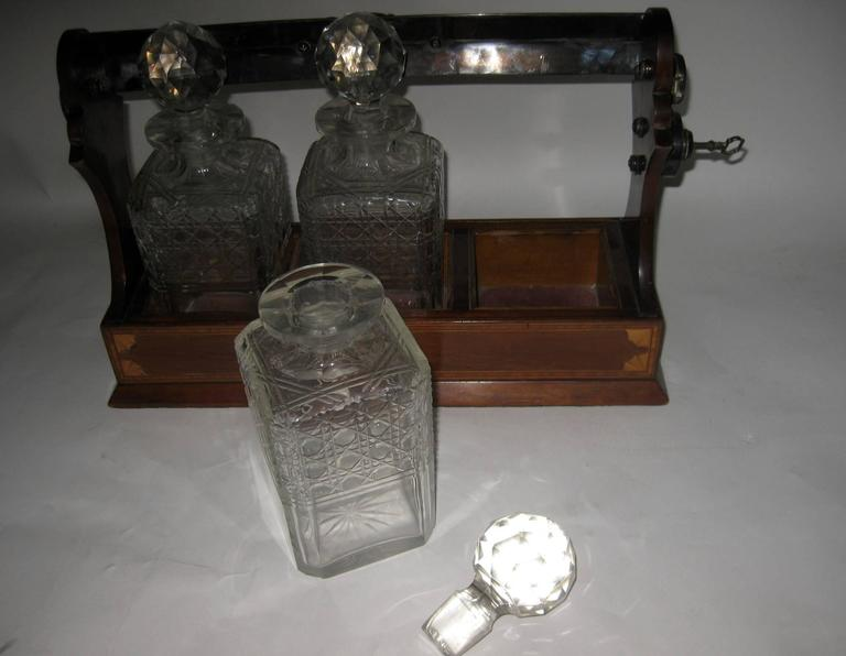 19th Century Georgian Inlaid Mahogany Tantalus with Three Decanters For Sale 3