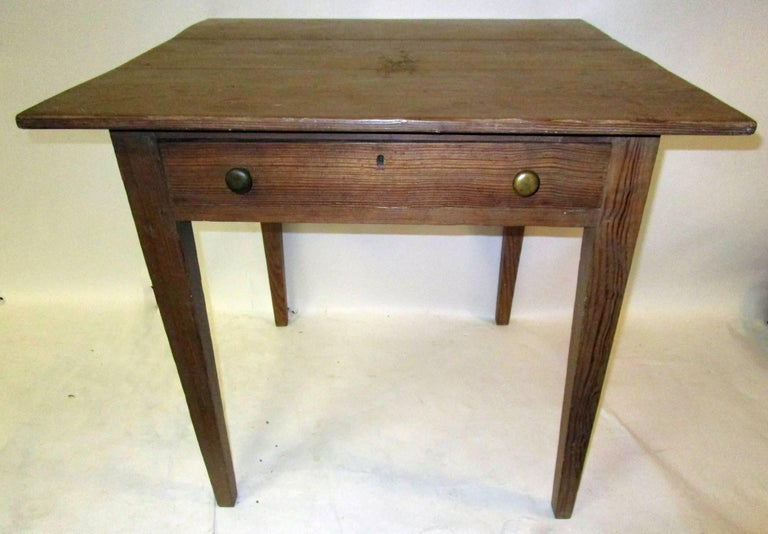 From Mississippi river plantation in Louisiana, this kitchen work table features one drawer with painted interior surface, square tapered legs and old brass pulls. See measurements below.