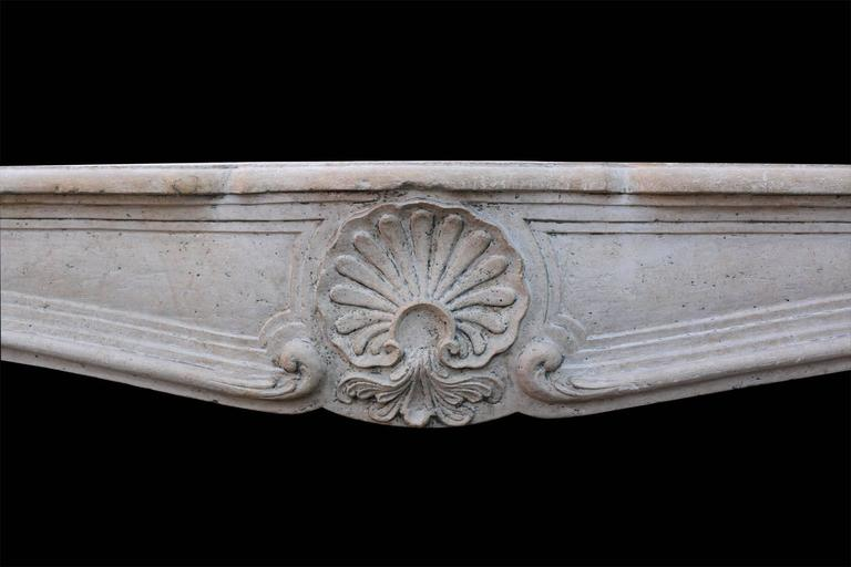 Carved 19th Century French Limestone Louis XV Style Fireplace Mantel For Sale