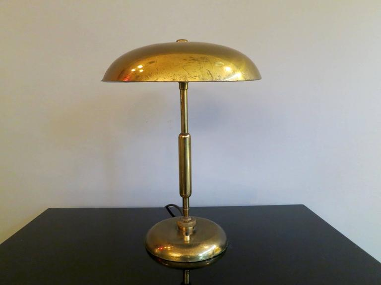 A pair of table lamps, one in brass and the other in nickel, with articulated base and shade for complete 360 degree movement. Can be sold separately,