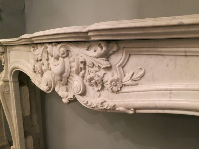 Carved French 19th Century Louis XV Marble Fireplace Mantel For Sale