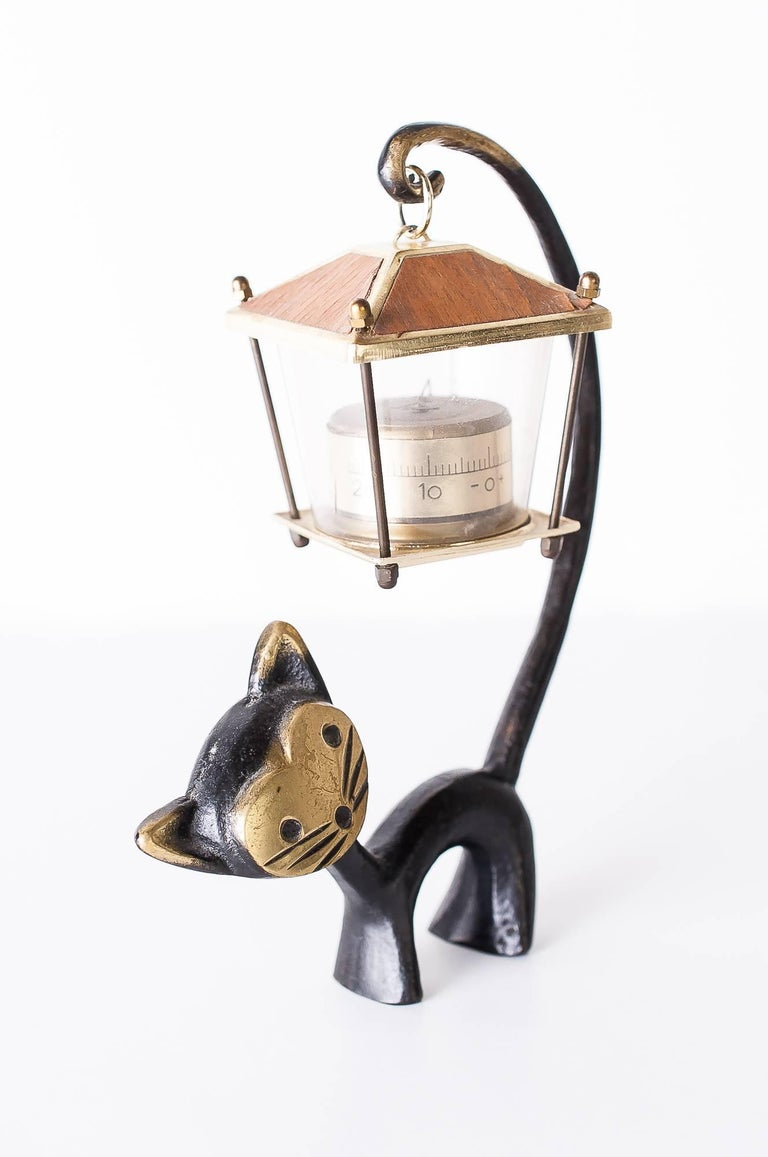 Walter Bosse cat figurine with thermometer, 1950s Austrian desk thermometer, cat figurine and a lantern-shaped thermometer. Designed by Walter Bosse, executed by Hertha Baller Austria in the 1950s. Original condition.