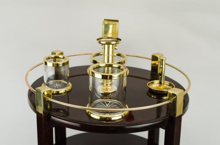 Very beautiful Viennese smoking table 1910s Polished mahogany wood Brass parts polished and stove enamelled cut-glass.