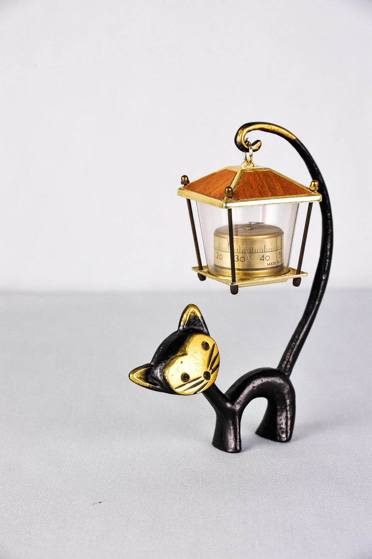 A very charming Austrian desk thermometer, consisting of a nice cat figurine and a lantern-shaped thermometer. A very humorous design by Walter Bosse, executed by Hertha Baller Austria in the 1950s. Made of brass, in good condition.