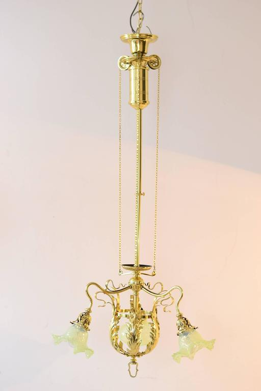 Adjustable jugendstil flowers chandelier with Palme König glass shades polished and stove enameled. Pulled in high: 94cm. Pulled out: 120cm.