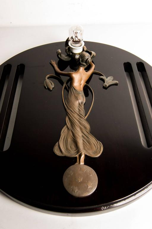 French Auguste Rubin Figural Bronze Wall Lamp on Wood For Sale