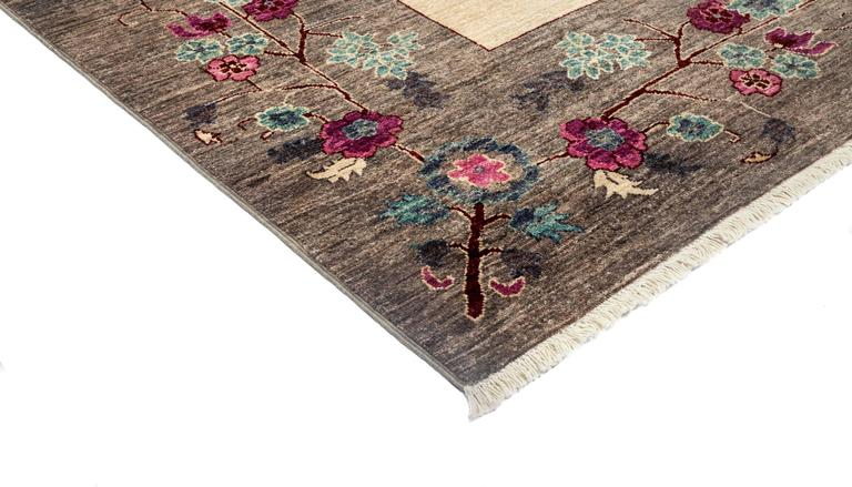 Inspired by embroidered Suzani textiles from Uzbekistan, this rug features floral motifs in modern palettes and compositions. Hand-knotted of vegetable-dyed wool, the rugs are designed to retain their vibrancy for generations to come.