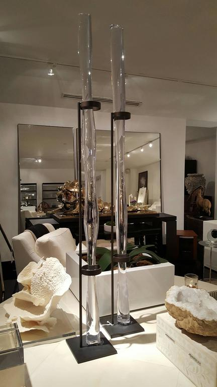 Beautiful crystal rod on vertical stand.