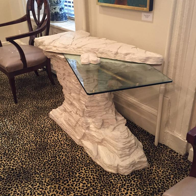 Incredible piece of design. Of asymmetric form; the top with original beveled plate glass that is secured with the floating stone for a surreal effect. Evocative of the rock work designs of John Dickinson and Emilio Terry.