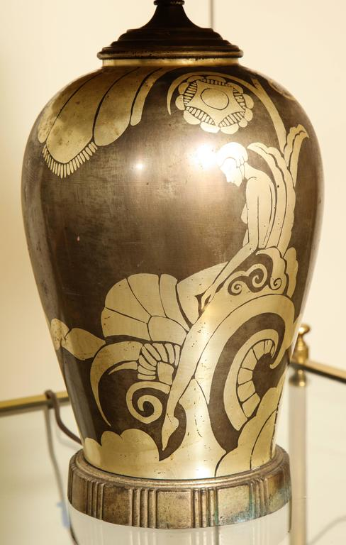 With most likely original hand-painted canvas pagoda-form shade. The vasiform base painted with a female figure sitting amongst stylized foliage. Wonderful coloration. Rewired.