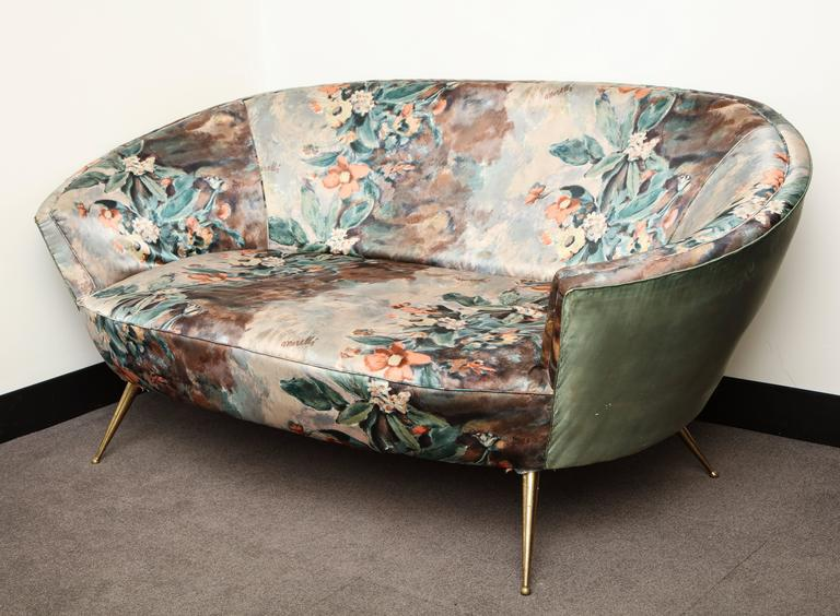 The fabric on this sofa was designed by the artist Enzo Morelli for the textile company Mocchetti. The I Fiori motif exhibits Morelli's painterly style and preference for bold colors. During the 1950s Morelli created three of four designs for