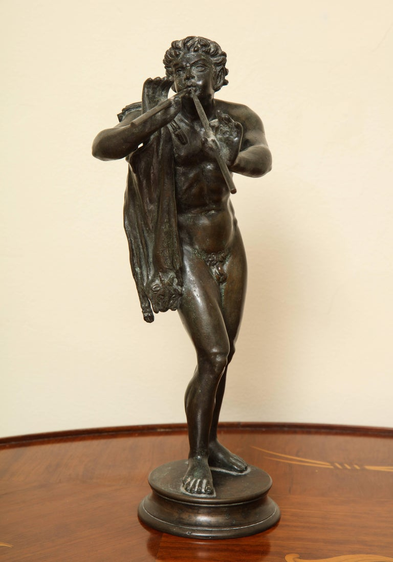 Finely rendered figure of Pan playing the panpipe. Made and supplied by the Florentine gallery Pietro Bazzanti in the 1960s as a Grand Tour souvenir. Pietro Bazzanti was a central figure in the production of Florentine sculpture at the end of the