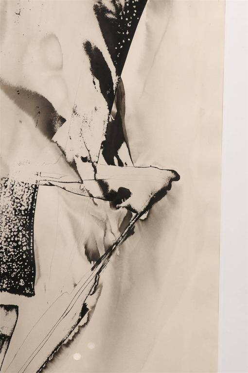 Unique abstract by abstract expressionist artist, Matsumi Kanemitsu (American, b. 1922-1992). Sumi ink on paper framed in museum quality glass. Signed by the artist.