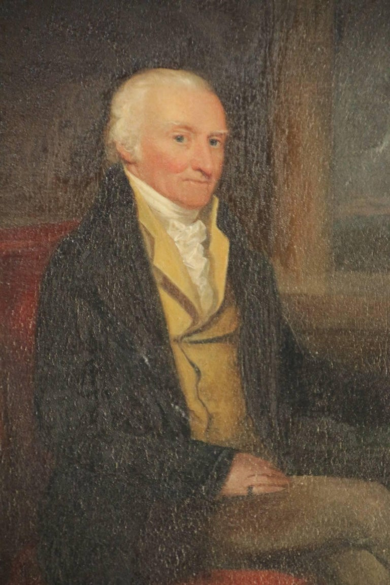 Portrait of a distinguished gentleman seated in a red velvet chair holding a hand written letter in original gilt-gesso frame.  Oil on board.  American or English.  Late 18th century.  Measures: 14.5 inches high by 13 inches wide.
